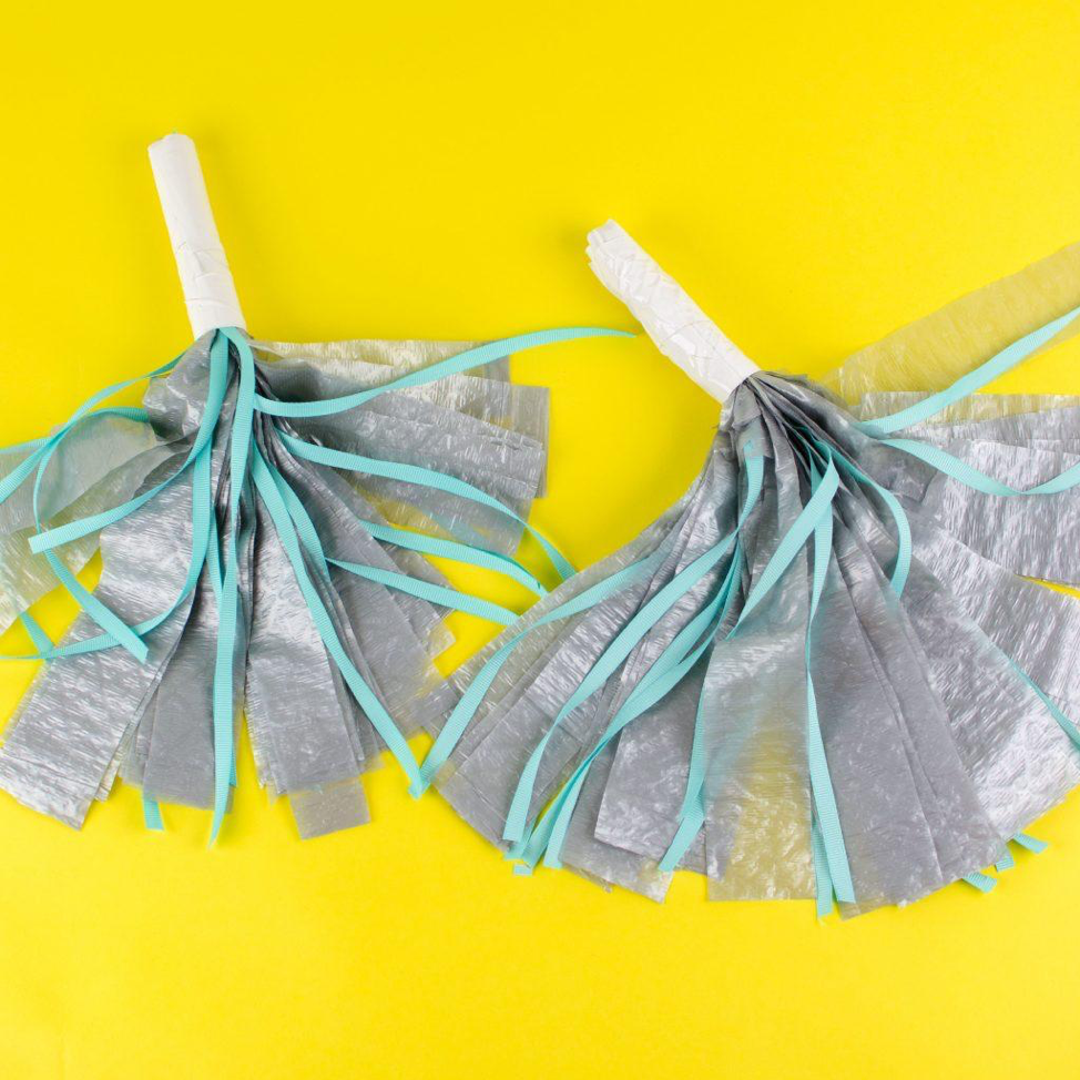 Diy Rally Pom Poms From Trash Bags A Little Craft In