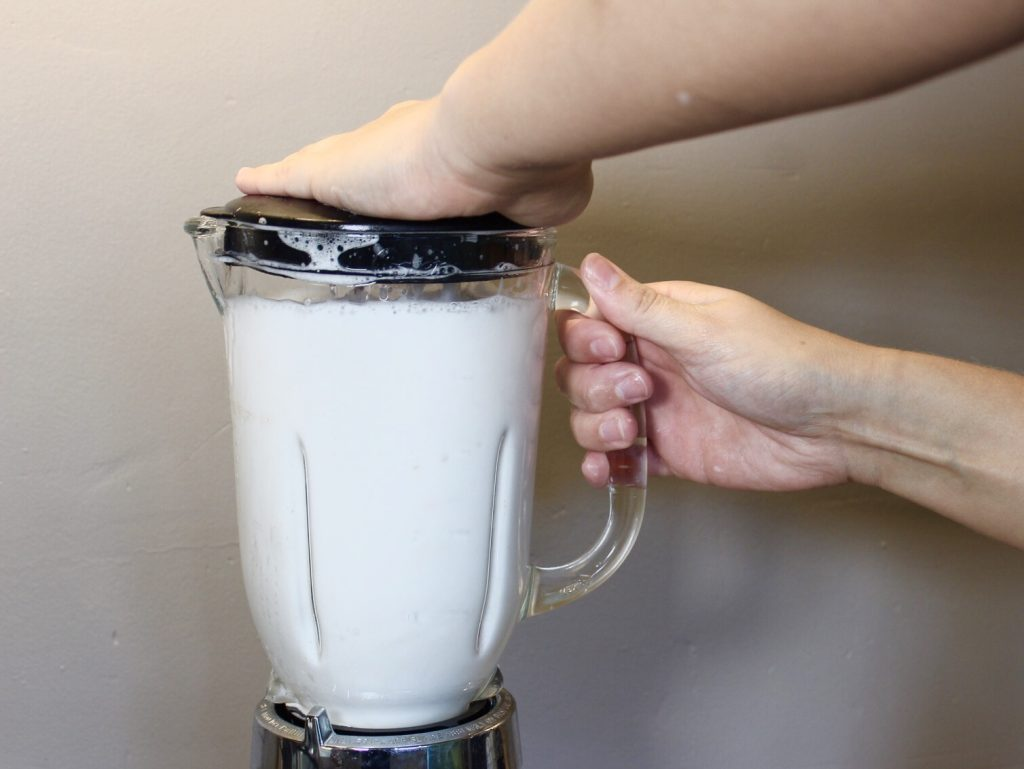 Adding Water and Dish Soap In Blender For Easy Cleanup